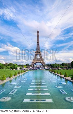 Symmetrical Front Panoramic View Of Eiffel Tower On The Bright Sunny Afternoon Taken From Fountains