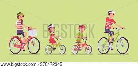 Happy Family Enjoying Bike Ride. Father, Mother, Son And Daughter Together In A Sport Activity Ridin