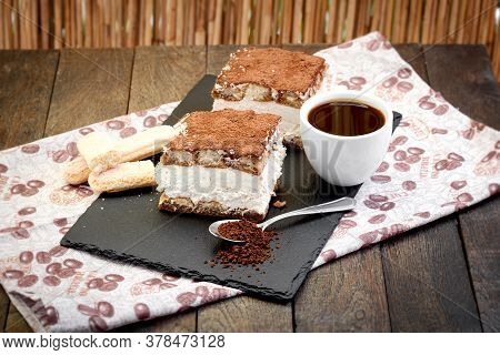 Tiramisu And Cup Of Coffee On Table, Delicious Dessert On Rustic Table