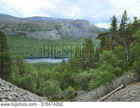 Northern Lapland Green Wilderness, Fells And Blue Lake Surrounded By Forest Seen From Pirunkuru Gorg