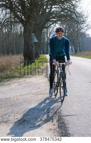 Bike Fix, Young Cyclist On The Road, The Cyclist In The Helmet Smiles, Kaliningrad Region, Russia, M