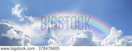 Stunning Blue Sky Panoramic Rainbow - Big Fluffy Clouds With A Giant Arcing Rainbow Against A  Beaut