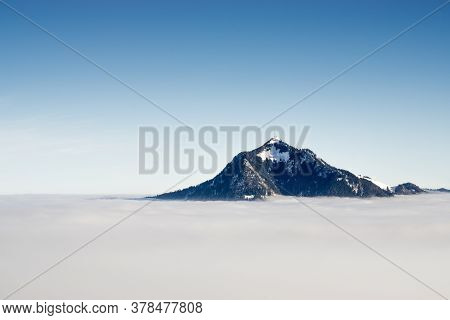 Mountain Stick Out Of Inversion Fog Cloud Layer. Above The Clouds Concept For Outstanding Business I