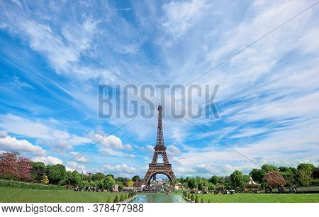 Symmetrical Front Panoramic View Of Eiffel Tower On A Bright Summer Day Taken From Fountains Of Troc