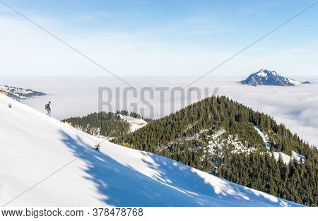 Man With Two Dogs Running Down Snow Mountain With Amazing View To Mountains Above Inversion Valley F