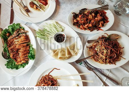 Assorted Chinese Food Set. Famous Chinese Cuisine Dishes On Table. Top View. Chinese Restaurant Conc
