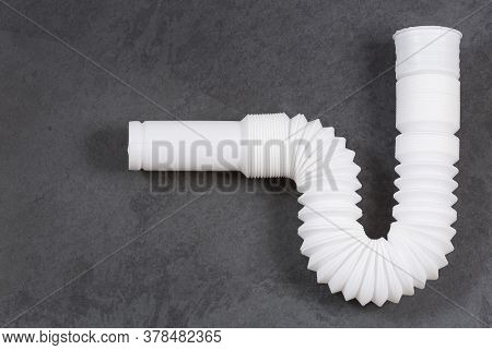 Plastic Pipe With Water Trap, Isolated - Plastic Flexible Siphon. Top View