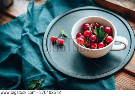 Ripe Cherries In A Mug. Good Morning Concept Cottagecore Aesthetics. Rustic, Vintage Style. Selectiv
