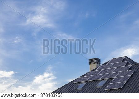 Saving Energy Concept. Solar Panels Close Up On A House Roof On Cloudy Sky Background