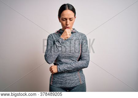 Young blonde fitness woman wearing sport workout clothes over isolated background feeling unwell and coughing as symptom for cold or bronchitis. Health care concept.