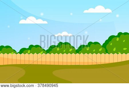 Blue Sky Background With Decorative Picket Wooden Fence And Grass. Garden Fencing, Summer Backyard.