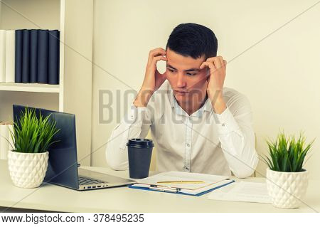 Serious Frustrated Asian Businessman Suffering From Headache Migraine At Workplace, Feeling Tired Ex