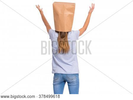 Rear view of teen girl with paper bag over her head with outstretched hands, isolated on white background. Child raised up arms - back view.
