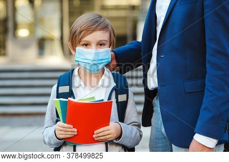 Businessman Father And Son Are Going To School. Dad And Schoolboy Wearing Face Mask. Schoolboy Is Re
