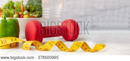 Diet And Healthy Life Loss Weight Exercise Concept. Green Apple And Weight Scale Measure Tap With Fr