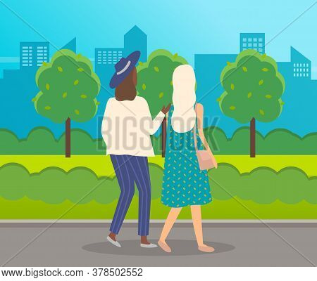 Women Walk In The Park. Meeting Of Girlfriends In Open Space. Two Friends Women Back View Walking In
