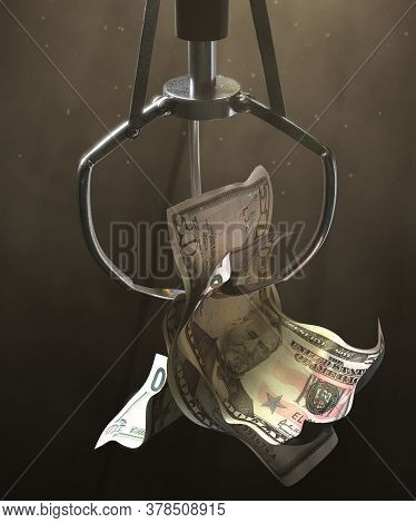 A Robotic Claw From An Arcade Type Game Gripping A Wad Of Creased Us Dollar Bank Notes On A Dark Moo