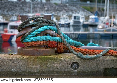 A Mooring Bollard With Colour Ropes Or Hawsers. Mallaig Harbour, Scotland