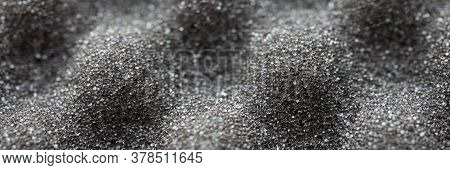 Close-up Of Dark Gray Polyurethane Foam Rubber Dishcloth Macro Shot. Convex Kitchen Sponge. Rough Gr