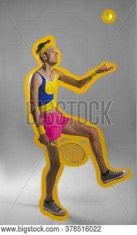 Vertical Image Of Sportsman Which Playing On The Tennis Racquet. Full Length Portrait Over Black And