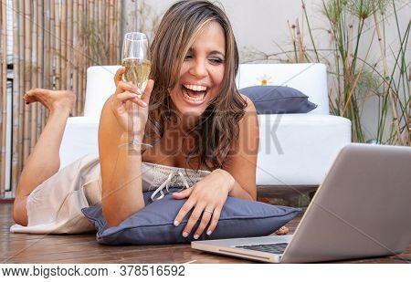 emotional girl with laptop and champagne during pandemic isolated