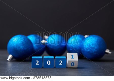 Happy New Year. Holiday Decoration. Festive Christmas Decor. Wooden Cubes In Line With Numbers, Blue