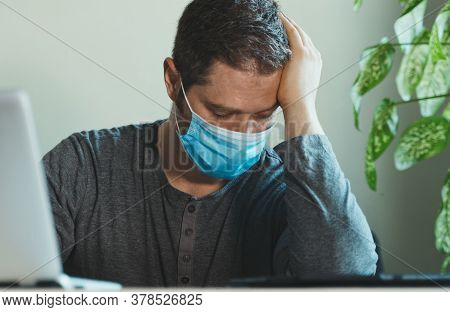 Man With Temperature In Medical Mask In The Office.