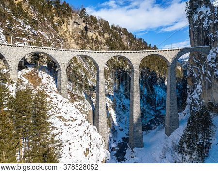Aerial Image Of The Landwasser Viaduct, Which Ia A Wonder Of Swiss Mountain Railway Engineering In 1