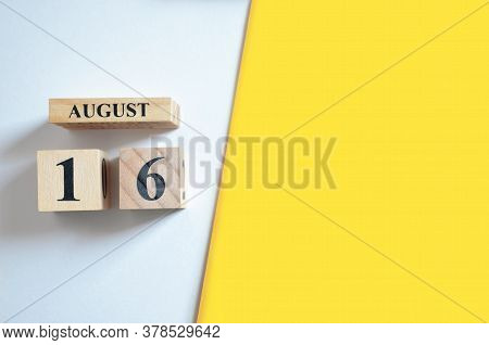 August 16, Empty White - Yellow Background With Number Cube.