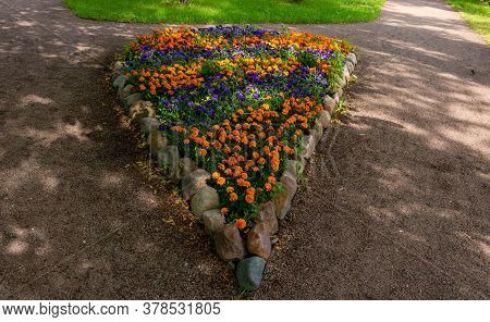 Beautiful Flowerbed In The Shape Of A Drop Of Bright Garden Flowers