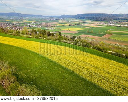 Aerial View Of Contryside With Rape Field Patches And Stripes