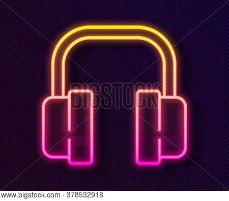 Glowing Neon Line Headphones Icon Isolated On Black Background. Support Customer Service, Hotline, C