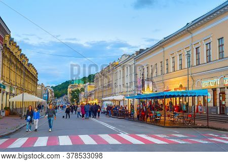 Kiev, Ukraine - May 31, 2020: People Walking By Old Town Street Of Kiev At Twilight.