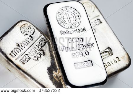 Kyiv, Ukraine - December 05, 2018: Several Silver Bars Of Famous World Manufacturers On A Light Back