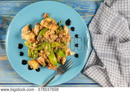 Fried Chicken And Vegetables On Blue Plate.