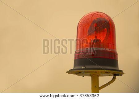Red Beacon On Yellow Metallic Rod Warning