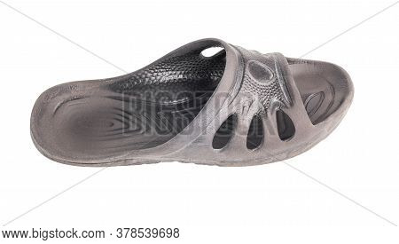One Used Cheap Black Soft Rubber Slipper With Signs Of Friction Wear Isolated On White Background
