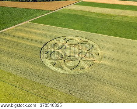 Canton Bern, Switzerland - July 05, 2019: Mysterious Crop Circle Emerged Overnight In Wheat Field Wi