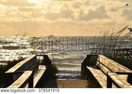 Sunrise, Boardwalk, High Tide And Tall Grasses. Beauty At The Beach.