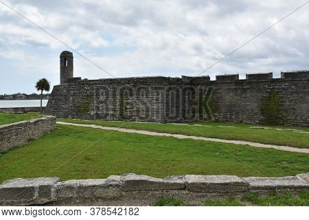 Ancient Fort With High Turret, Stone Walls And Blue Skies