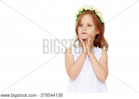 Studio Portrait Of A Beautiful Little Girl. The Concept Of Fashion, Family Happiness, Harmonious Dev