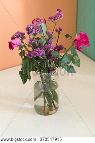Beautiful Withered Pink Roses Bouquet On Color Background. Dying Beauty