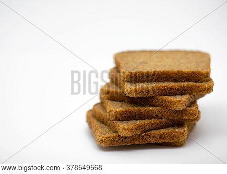 Seven Pieces Of Wholemeal Bread On A White Background