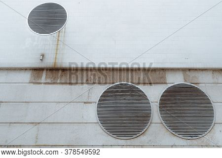 View Of A Dull Futuristic Wall In Cyberpunk Style With Three Huge Round Ventilation Shafts Covered W