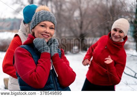 Senior Women Friends Dancing And Smiling After Outdoors Training In Park . Active Lifestyle And Frie