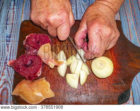 Cutting Onions With A Knife For Preparing A Meat Dish. Food Photo. Meat Dish. Preparing Food. Cuttin