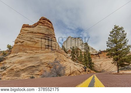 Ground Perspective Of An Impressive Rock Formation In The Zion National Park In Winter