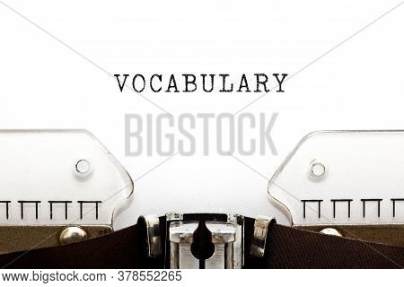 The Word Vocabulary Typed On Vintage Typewriter With Copy Space.