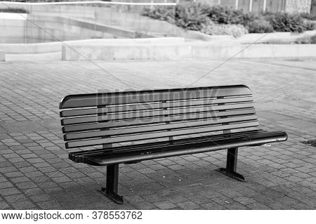 Urban Furniture. Outdoor Bench Or Seat. City Bench With Backrest. Street Bench On Paving Slab. Rest