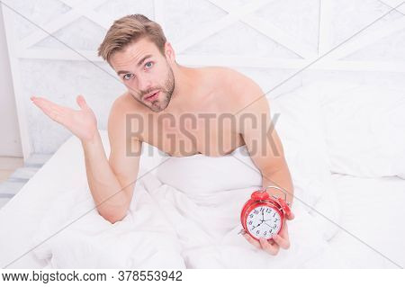 Man Waking Up Early Morning Ringing Alarm Clock, Insomnia Concept.